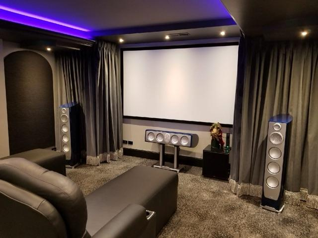Contemporary Home Theater With Purple Accent Lighting
