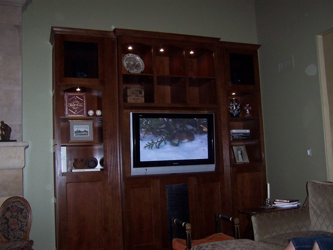 Custom Cabinetry With 3 Tvs And Speaker Grill Covers